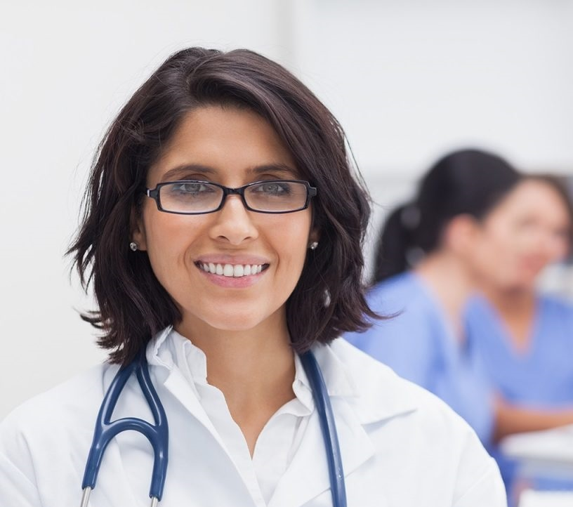 doctor-smiling-and-her-team-on-background-xxl-cropped-1200x800.jpg